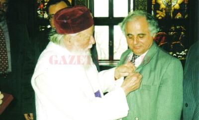 """Scriitorul Tudor Nedelcea a primit """"Crucea Patriarhală"""" de la Patriarhul TeoctisT"""